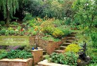 GAP Gardens - Steps up terraced garden with brick raised ...