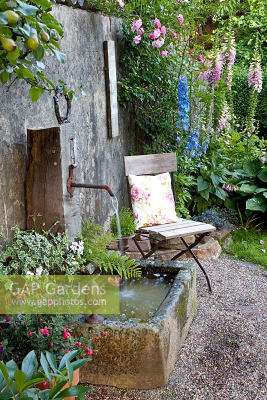 GAP Gardens  Seat near rustic water feature  Image No