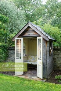 GAP Gardens - Small timber summer house with bench seat ...