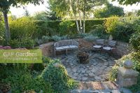 GAP Gardens - Sunken patio area with seats and border ...