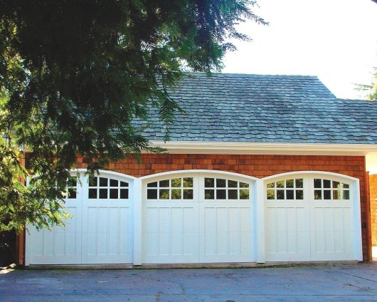 Carriage house wood with 8 lite arch windows