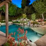 Award Winning rock swimming pool with firepit and beach entry