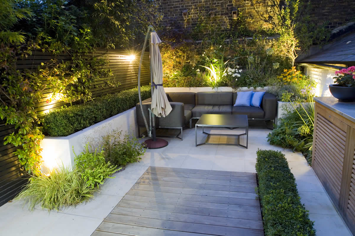 Outdoor room in Sloane Square Chelsea with Gloster exterior furniture and lighting and timber