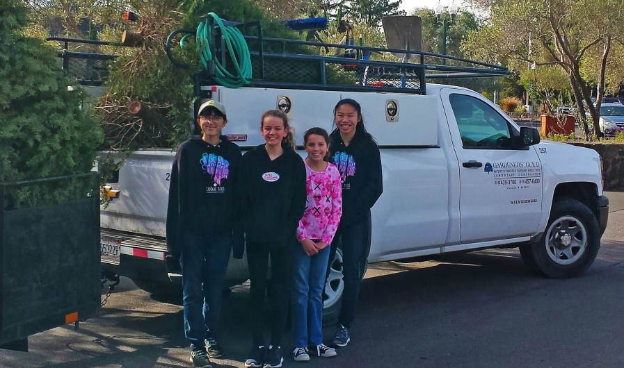 Girl Scouts from Troop #10240 in front of Gardeners' Guild truck