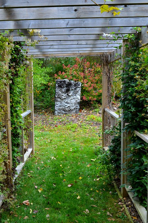 Natural quartz stone is a piece of natures art. Located at the end of 40 foot arbor makes it a nice focal point that leads visitors down the path, located in Aspen Grove Gardens, by Robert Pavlis Adding Art to the Garden