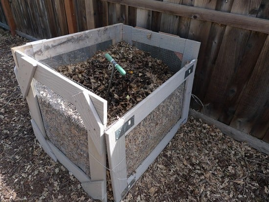 An easy DIY compost bin made of wood and wire mesh