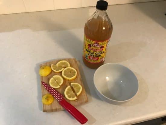lemon, apple cider vinegar and bowl