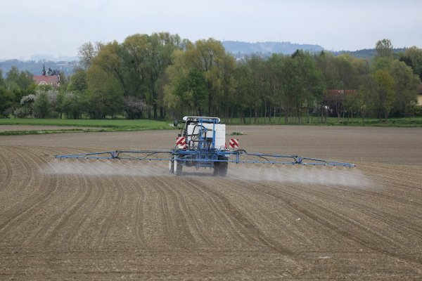 farmer using pesticides on crop