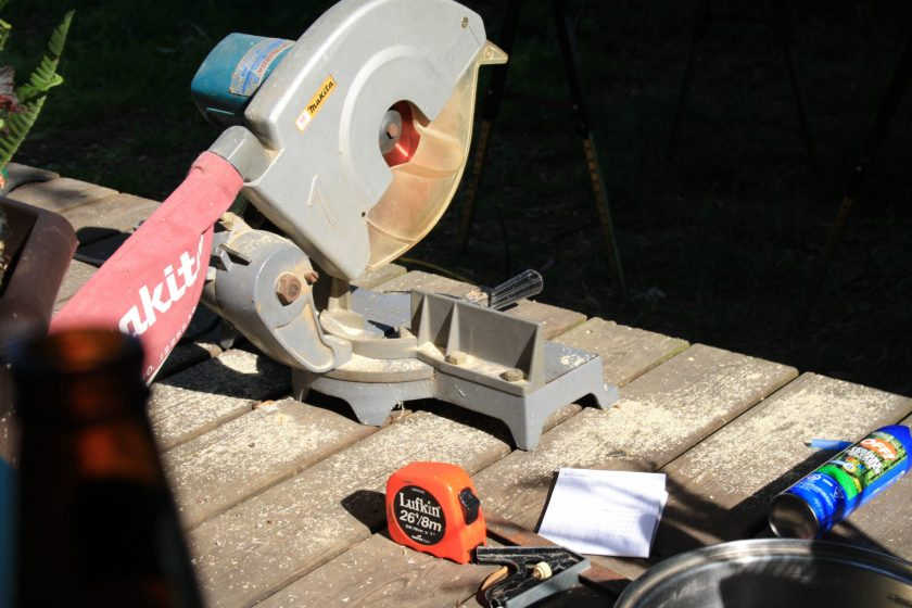 Miter Saw, Tape Measure and Beer