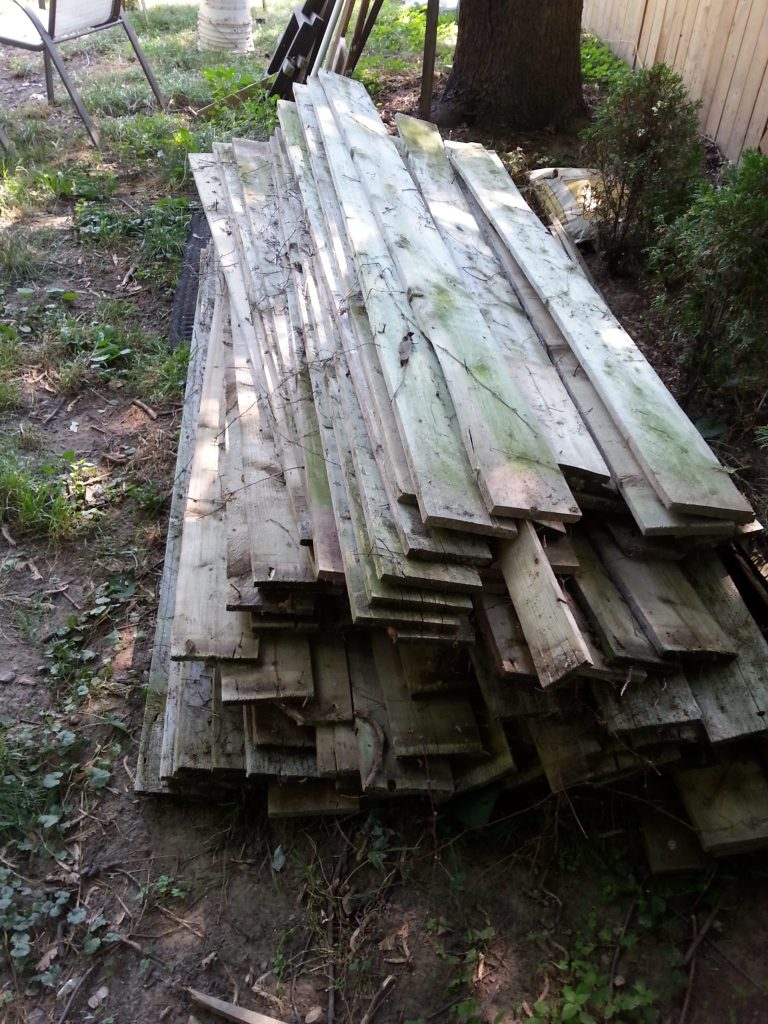 Stack of old fence boards