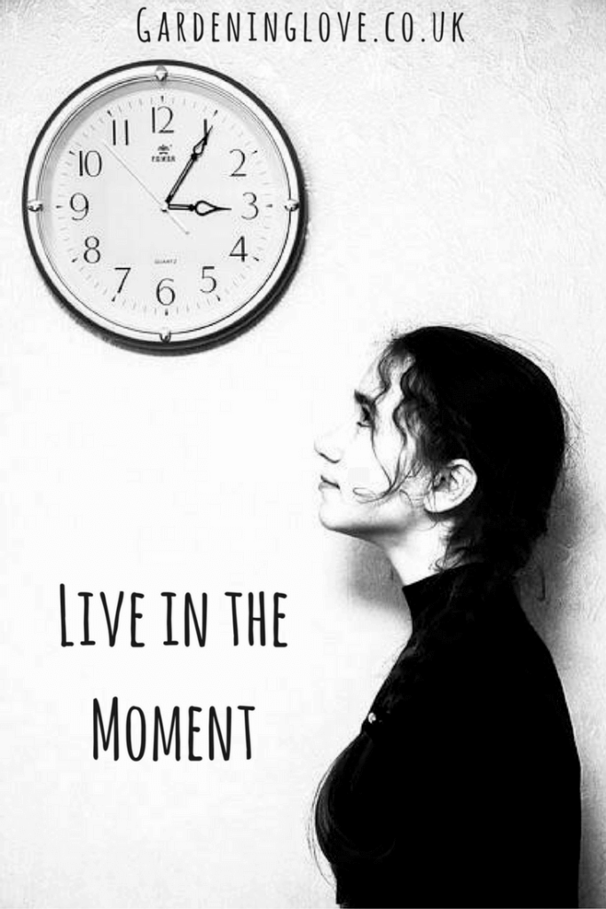 Women looking at a clock as she tries to live in the moment braking bad habits