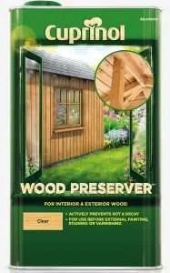 Wood preserver can be applied to untreated timber before painting a summerhouse.