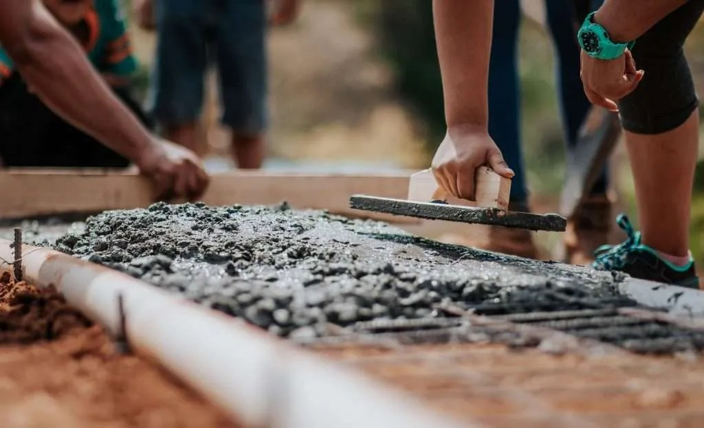 A concrete base provides a solid and level foundation for a garden building.