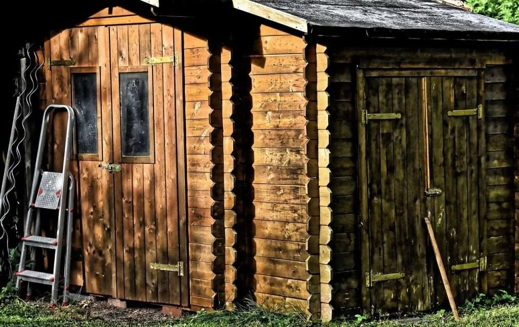 Making a shed watertight with wood treatment and sealant.