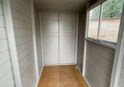 A painted shed interior with no lining.