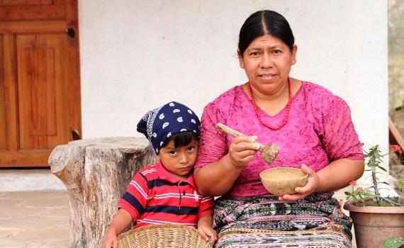 Garden's Edge Microloan recipient, Fabiana, with her son.