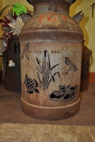Milk jug with reptile and insect designs