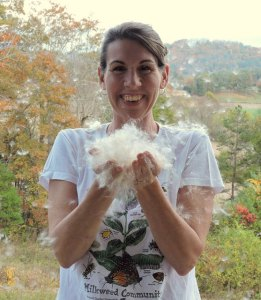 Kim with a handful of milkweed. Photo courtesy of Kim Bailey.