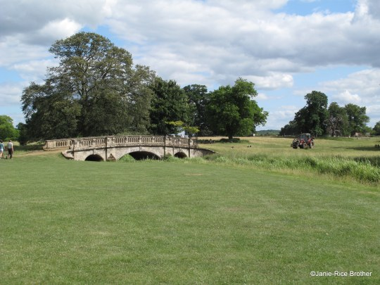 A view of the Parkland – I enjoy the dichotomy of the graceful bridge and the modern tractor at right.