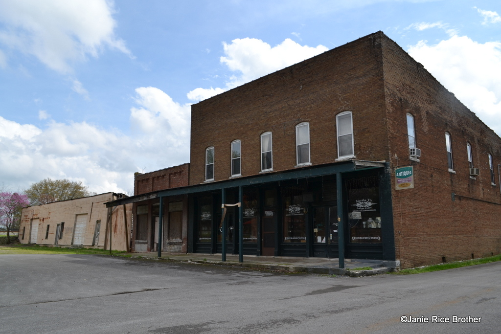 The survivors of what was once a thriving commercial square in Woodburn, Kentucky.