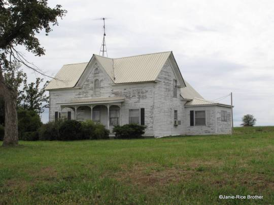 A vernacular Gothic Revival (with a Queen Anne-inspired porch) in rural Livingston County, Kentucky.