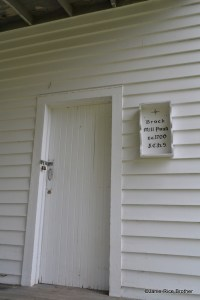 One of the first floor doors on the mill and a sign installed by the local historical society.