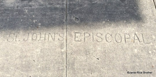 The sidewalk in front of the church, bearing the name of the congregation that originally occupied the building.