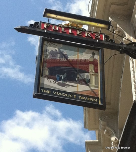 Pub sign in London, England.
