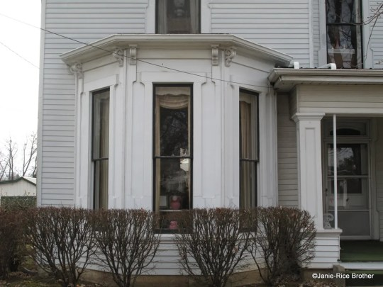 A perfect example of a polygonal bay window (with brackets) on a late-19th century house in Harrodsburg, Mercer County, Kentucky.