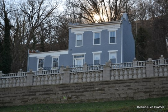 Two types of balustrades are visible in the photo of a house in Maysville, Kentucky: two stone balustrades, and what appears to be a replacement metal balustrade on the house itself.