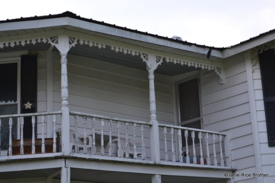 One of the most common porch balustrades in Kentucky, from the late-19th century into the 20th is the open rail, with turned and chamfered balusters. Often, the porch posts mimic the balusters and are also turned and chamfered. This example is from the community of Summer Shade in Metcalfe County, Kentucky.