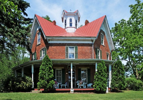 This octagon house in Ohio was built in 1883 by Ezekiel B. Zimmerman, one of 23 octagon-shaped houses in the state. Most, however, do NOT have a a gabled roof like this example. Wikimedia Commons Photograph.