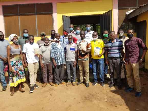 GARDJA members in a group picture with staff of Kabeli cashew processing factory