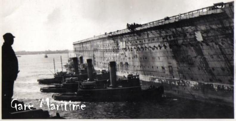 Normandie (USS Lafayette) being towed to the scrapyard