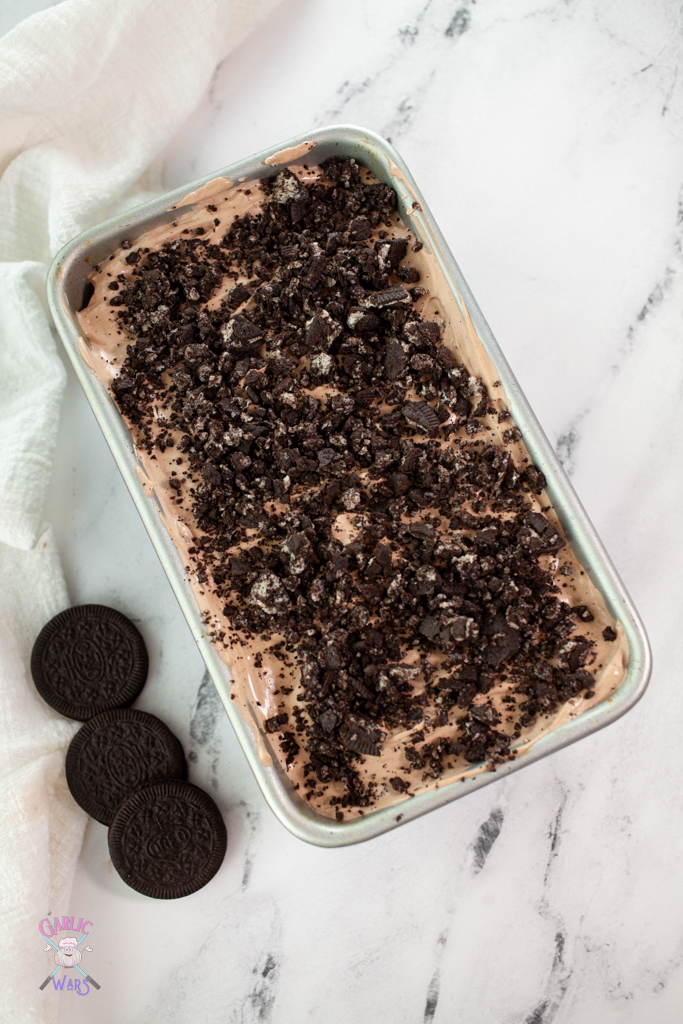 ice cream in loaf pan with Oreos