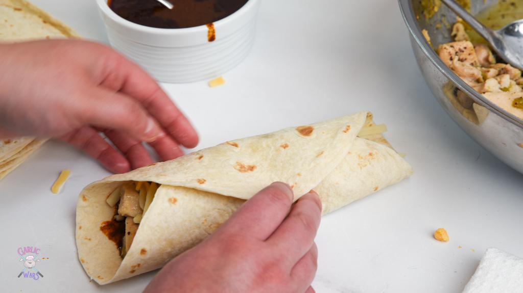 folded tortilla for chicken enchiladas