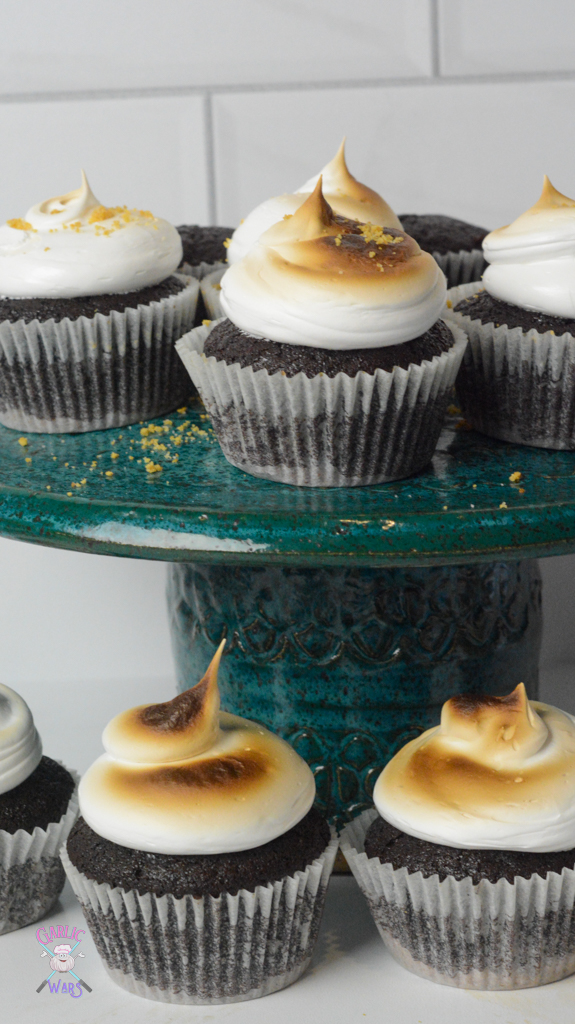 smores cupcakes on teal cake stand with cupcakes on surrounding table