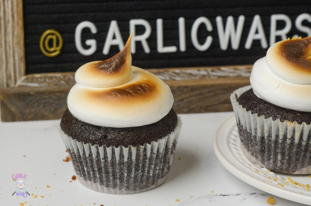 """smores cupcakes in front of letterboard sign that reads """"garlic wars"""""""