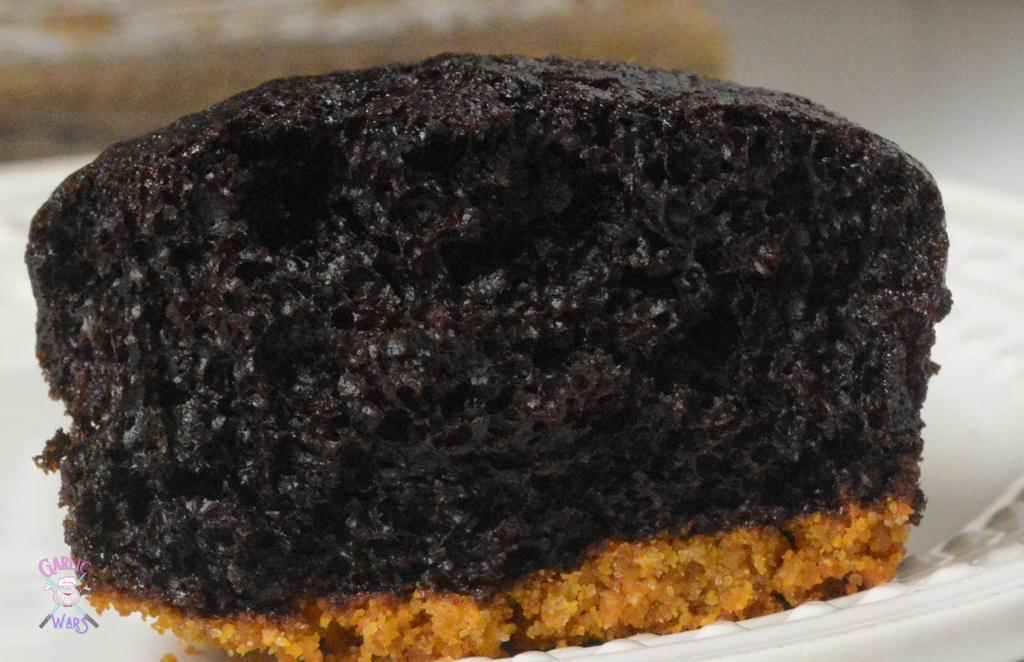 chocolate cupcake cut open to show moist texture inside