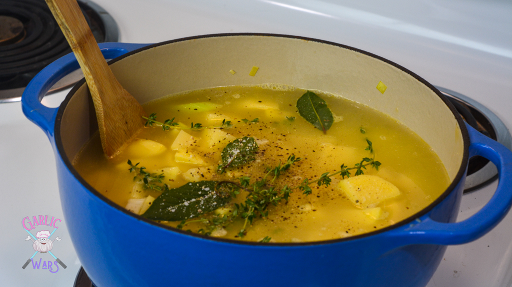 herbs, spices, chicken broth, and potatoes added to the pot