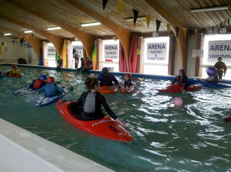 Canoes in a swimming pool