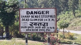 Sign in Nepal saying steep hills and sharp bends