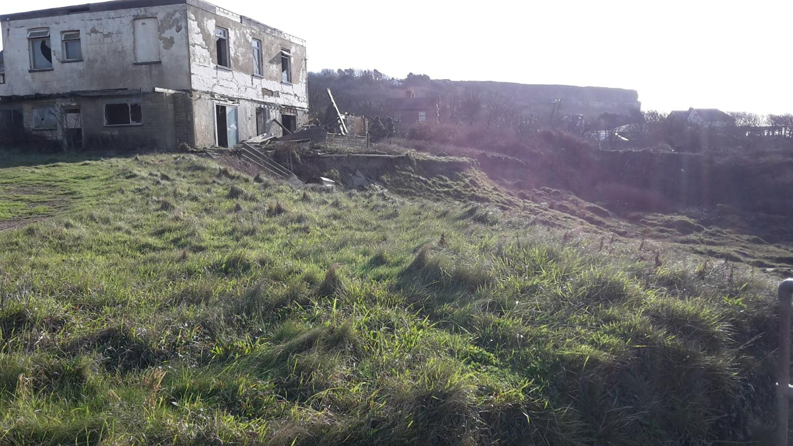House on cliff edge