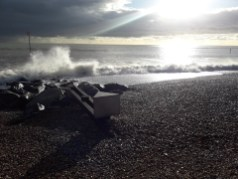 Waves crashing on the beach in the winter sun
