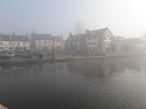 Water and buildings in the mist