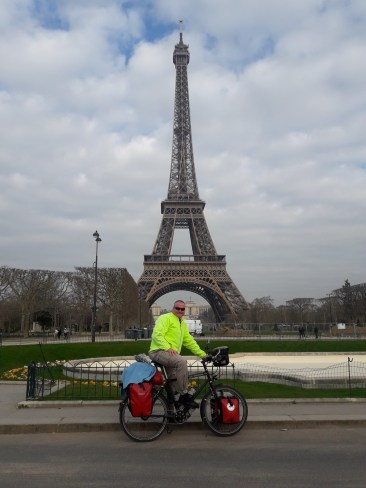 man bike Eiffel Tower