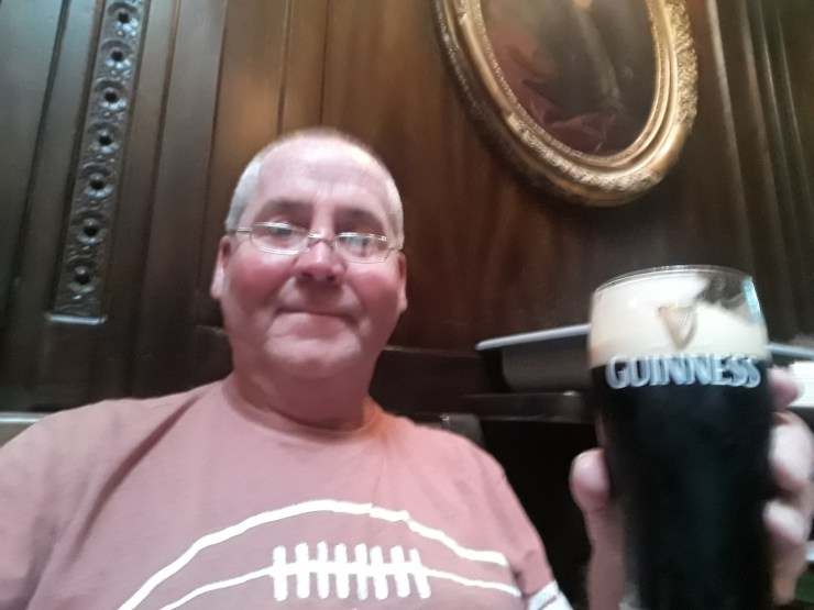 Man with pint of Guinness