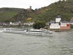 More castles across the river, with one of the many boats that cruise the Rhine