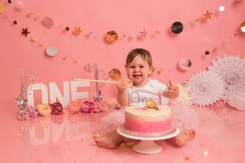 Baby girl with birthday cake