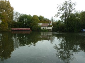 Cottage on a river bank